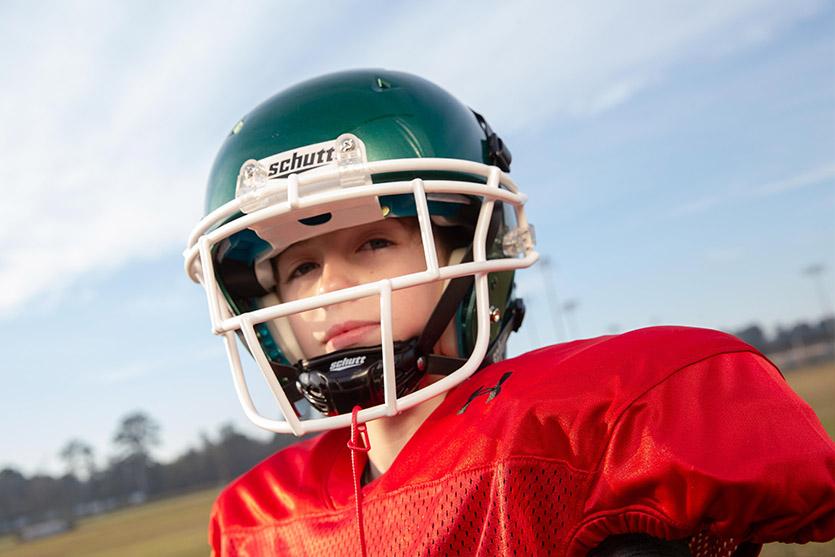 How to put a chin strap on a football helmet coastalfloridasportspark 1